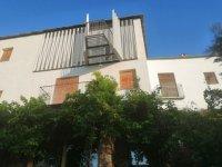 fachada casa de los vientos con balcón volante